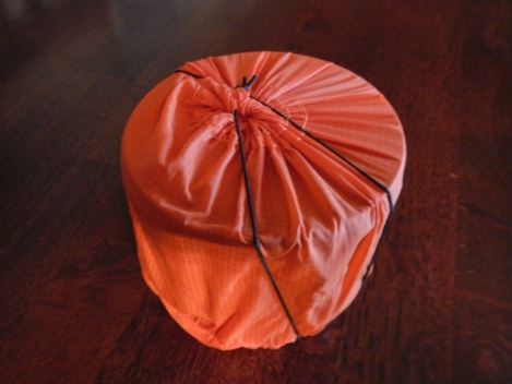 Silnylon stuff sack, secured with shock cord.