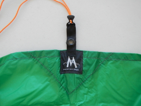 Center long side tie out on one side has webbing with a grommet for trekking pole tip